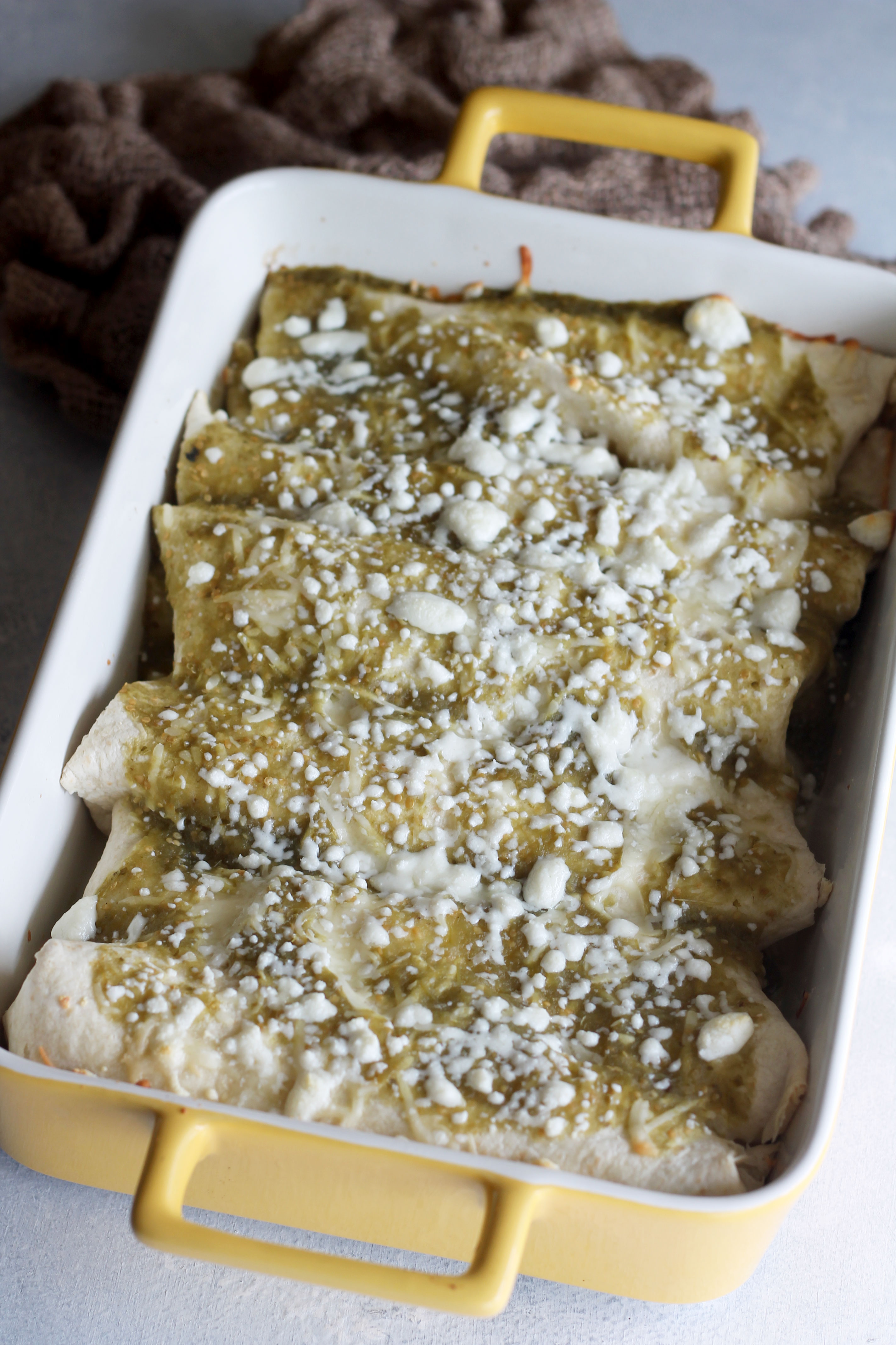 Skip going out to eat and stay in tonight to make these Creamy Chicken Enchiladas