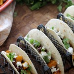 Butternut Squash and Black Bean Tacos will become your new go to meal! Full of flavor by being tossed in a smoky vinaigrette and topped with tangy goat cheese and cilantro