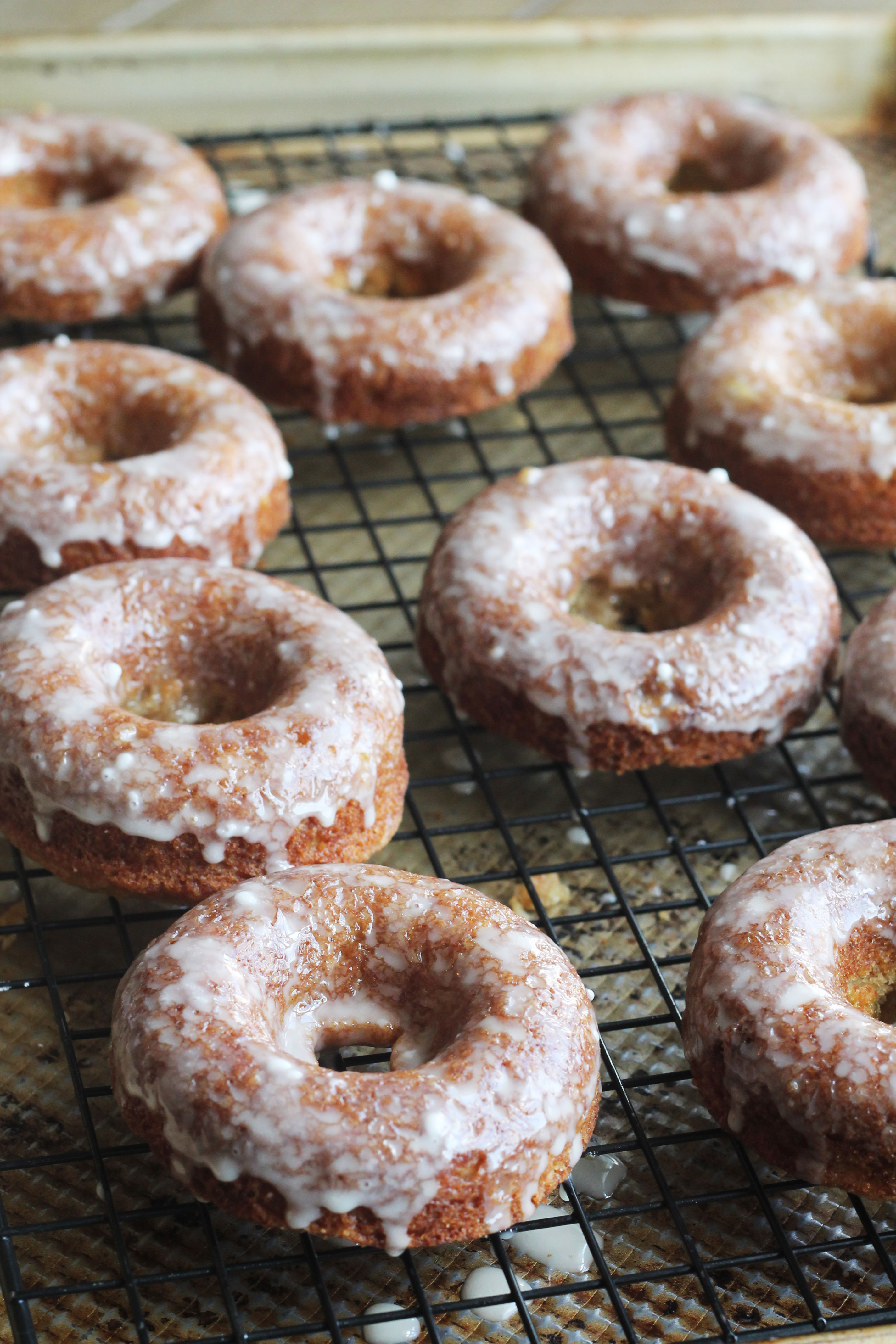 Apple Cider Donuts that are baked and then coated in a sweet cider glaze