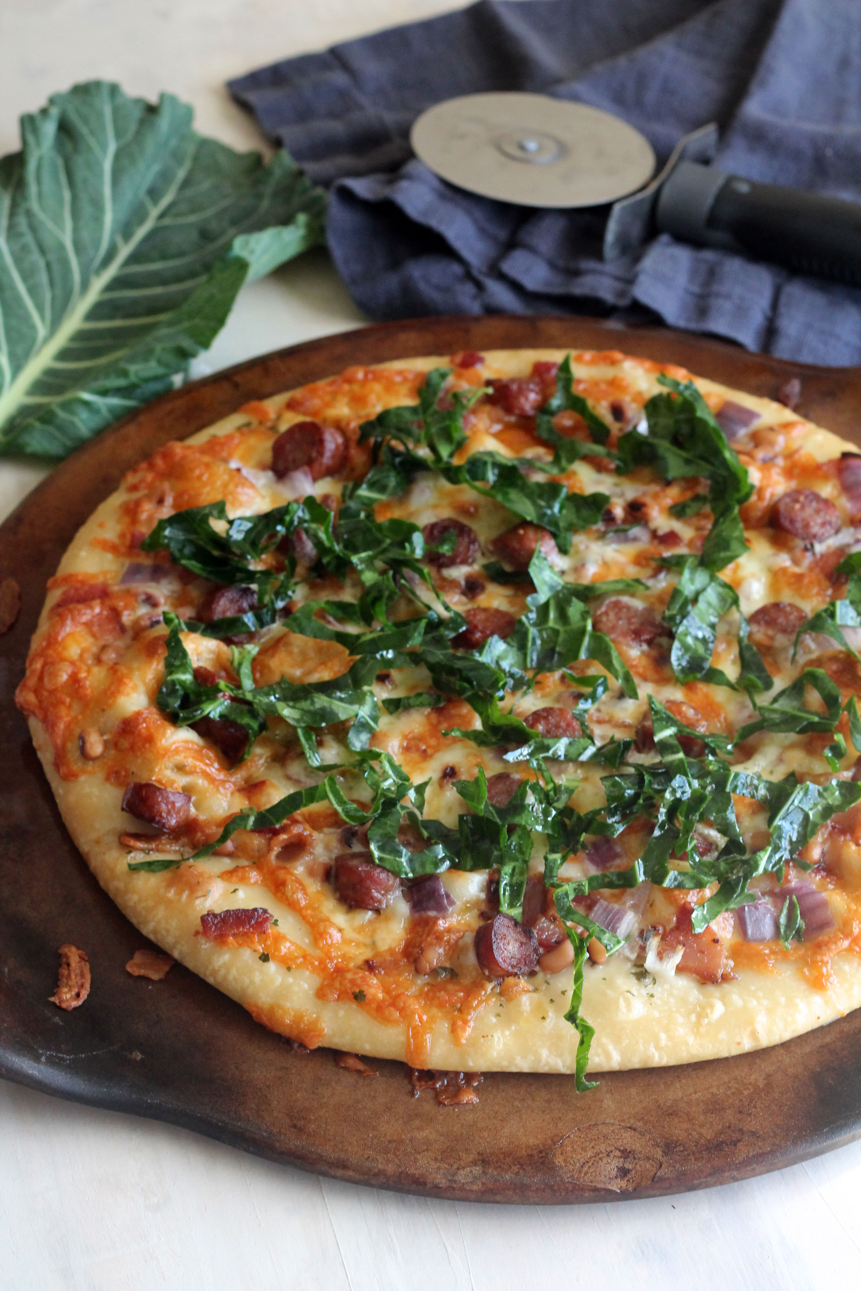 Black Eyed Peas, Collard Greens, and Sausage Pizza to bring good luck in the new year